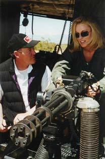 John Fox shows actress Jennifer Johnson the finer points of the 7.62mm M134 Mini Gun